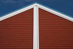 Red and white roofline pointing skyward Stock Photo
