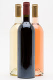 Red white and rose wine bottles. In formation stock photography