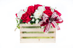 Red and white rose in a wooden basket with beautiful ribbon, gif Stock Images