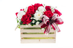 Red and white rose in a wooden basket with beautiful ribbon, gif Stock Photos