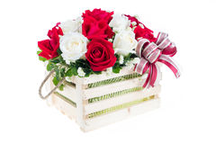 Red and white rose in a wooden basket with beautiful ribbon, gif Royalty Free Stock Photography