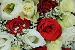 Red and white roses in a bridal bouquet. Red and white roses in a floral wedding centerpiece Stock Image