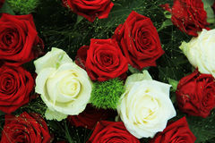 Red and white roses in a bridal bouquet. Red and white roses in a floral wedding centerpiece Royalty Free Stock Photos
