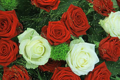 Red and white roses in a bridal bouquet. Red and white roses in a floral wedding centerpiece Royalty Free Stock Images