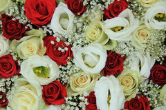 Red and white roses in a bridal bouquet. Red and white roses in a floral wedding centerpiece Stock Images