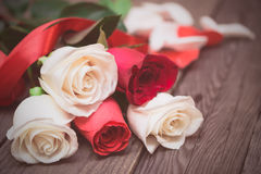Red and white roses on a dark wooden background. Women' s day, V Stock Images