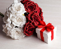 Red and white roses and gift box Stock Image