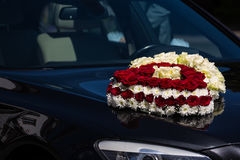 Red and White Roses Heart Wedding Car Hood Headlight. Red and White Roses Heart Wedding Car Hood royalty free stock images