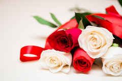 Red and white roses on a light wooden background. Women' s day,. Valentines Day, Mothers day. Copy space, selective focus stock photo