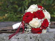 Red and white roses wedding bouquet. On the rusty well Royalty Free Stock Images