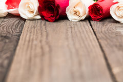 Red and white roses on wooden background. Women' s day, Valentin Royalty Free Stock Images