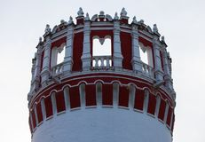 Red and white round tower of the monastery. stock photography
