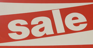 Red and white sale sign indicating a discount Royalty Free Stock Photography