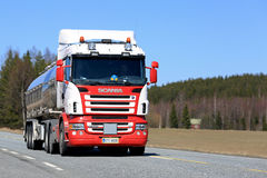 Red and White Scania Semi Tanker on Sunny Highway stock photos