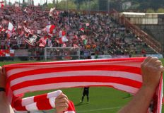 Red and white scarf of the fans in the Stadium 3 Stock Image