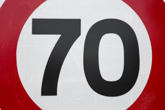 Red and White Seventy Speed Limit. Sign Stock Photo
