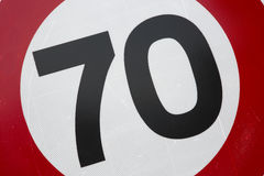 Red and White Seventy Speed Limit. Sign Stock Photos