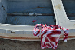 Red-white shirt on old boat Royalty Free Stock Photos
