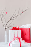 Red and white shopping bags and gift boxes Stock Image