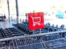 Red and white shopping cart icon at local grocery store royalty free stock photo