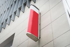 Red and white sign board for advertise in a clean white high bui Stock Photos