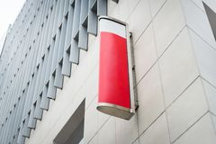 Red and white sign board for advertise in a clean white high bui Royalty Free Stock Photos