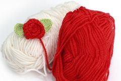 Red and white skein with crochet rose. On white background Stock Photos