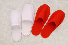 Red and white slippers from hotel, red and white slippers from a Stock Images