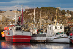 Red and white small fishing boats Stock Photos