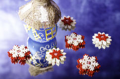 Red with white snowflakes and Christmas hut. Royalty Free Stock Photography
