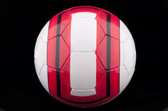 Red and white soccer ball Royalty Free Stock Photography