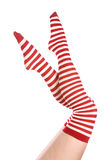 Red and white socks legs up Stock Image