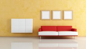 Red and white sofa  in a orange living room Stock Images