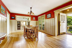 Red and white spacious dining room  with exit to backayrd area Royalty Free Stock Images