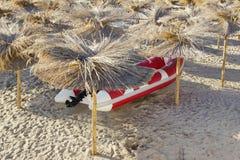 Red White SpeedBoat Under Beach Umbrella Royalty Free Stock Image