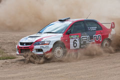 Red and white sport car Mitsubishi Lancer at rally. ROSTOV, RUSSIA - JULY 27: Alexey Petrov drives a Mitsubishi Lancer  car during Rostov Velikiy Russian rally Stock Photos