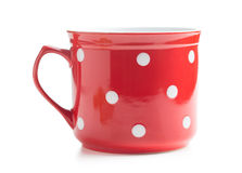 Red and white spotted mug. Stock Image