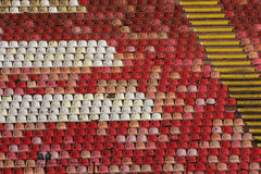 Red and white stadium seats. Empty red plastic seats in a stadium Stock Photography