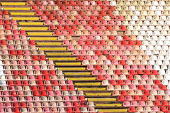 Red and white stadium seats. Empty red plastic seats in a stadium Stock Photo