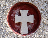 Red and White Stone Cross Stock Photo