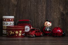 Red and White Storage Boxes, Toy Car and Retro Radio on Brown Ba Stock Image