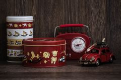 Red and White Storage Boxes, Toy Car and Retro Radio on Brown Ba Stock Photography
