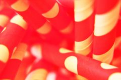 Red and white straw. Red straw with white polka dot and white stripe Stock Photo