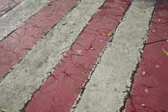 Red and white streaks of paint on asphalt. Markings for the parking of fire engines stock photography