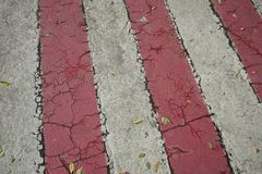 Red and white streaks of paint on asphalt. Markings for the parking of fire engines stock image