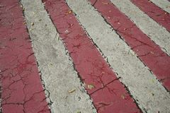 Red and white streaks of paint on asphalt. Markings for the parking of fire engines stock photos