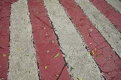Red and white streaks of paint on asphalt. Markings for the parking of fire engines stock photo