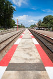 Red & white Strip Footpath between railway Stock Photo