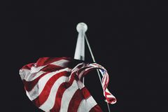 Red and White Stripe United State of America Flag Raising Stock Images