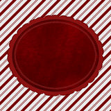 Red and White Striped Candy Cane Striped Background with Red Plu Royalty Free Stock Photos